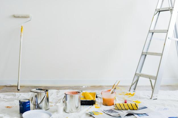 Buckets of paint on the floor