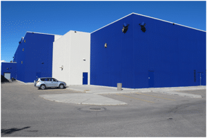 Calgary Painters | Exterior of commercial building with new paint in bright blue.